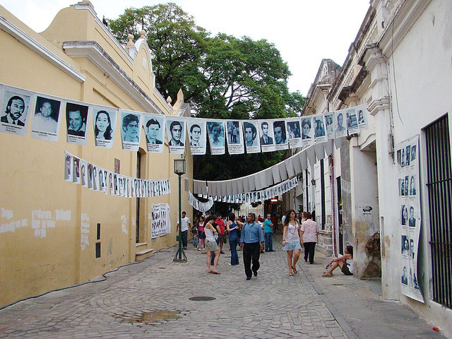 Photos of those disappeared by the military junta commemorate the Dirty War in Argentina. (Photo by Pablo Flores, via Flickr)